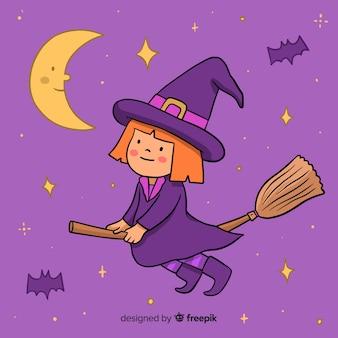 Strega di halloween carino su una scopa