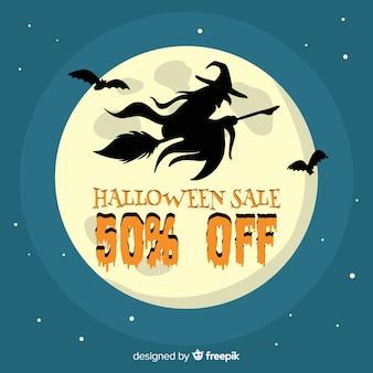 Strega di vendita di halloween che vola davanti alla luna piena