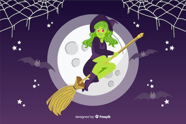 Strega su uno sfondo di halloween notte di luna piena
