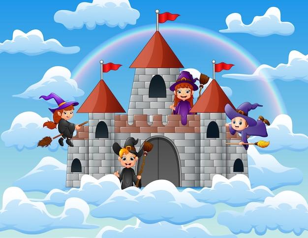 Streghe con la sua scopa magica volarono attorno al castello