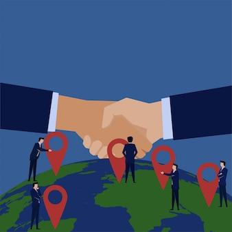 Stretta di mano del team aziendale per accordo di espansione e franchise