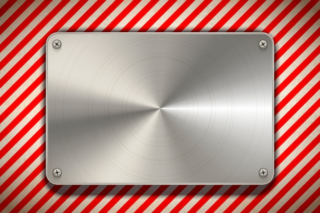 Strisce rosse e bianche del segnale di pericolo con il piatto in bianco del metallo lucidato, fondo industriale