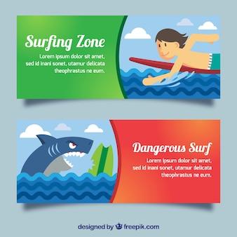 Striscioni di surf divertente con un surfista e uno squalo