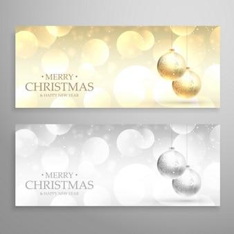 Striscioni festa di natale o le intestazioni impostati in stile d'oro e d'argento