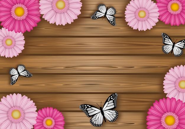 Struttura delle farfalle e dei fiori su fondo di legno