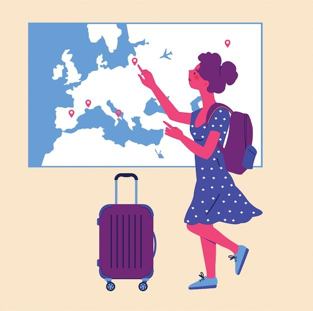 Studente con uno zaino e una valigia in piedi davanti a una mappa del mondo. istruzione internazionale, backpacker, scuole internazionali.