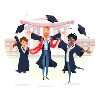 Studenti felici degli uomini e della ragazza che celebrano laurea