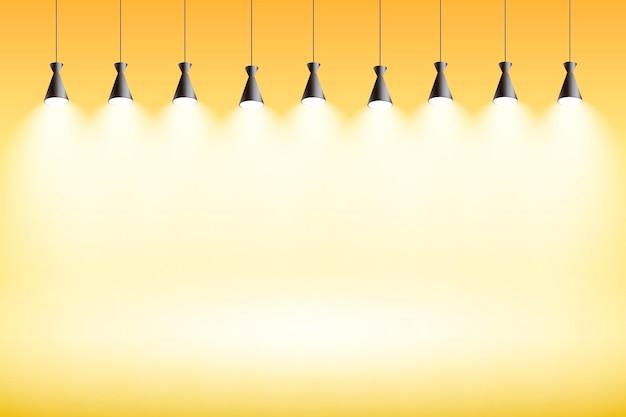 Studio di giallo del fondo delle luci spot