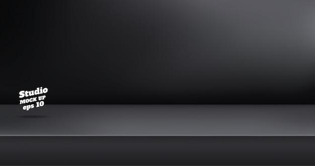 Svuoti il fondo nero della stanza della tavola dello studio di colore