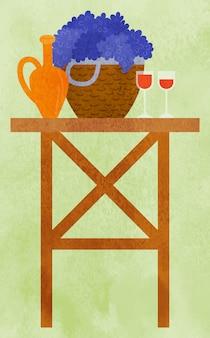Tabella con il cestino dell'uva e del vettore di vetro di vino