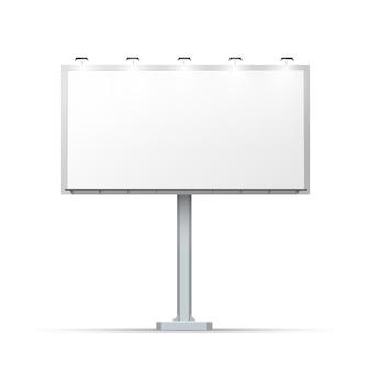 Tabellone per le affissioni all'aperto in bianco con il posto per la pubblicità e con illuminazione