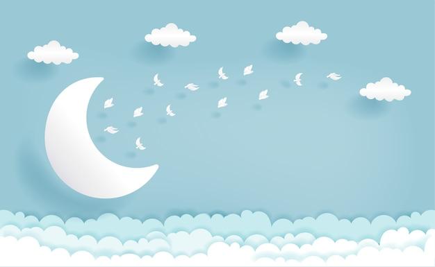Taglio della carta a mezzaluna e nuvole