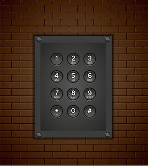 Tastiera del telefono su sfondo di mattoni.