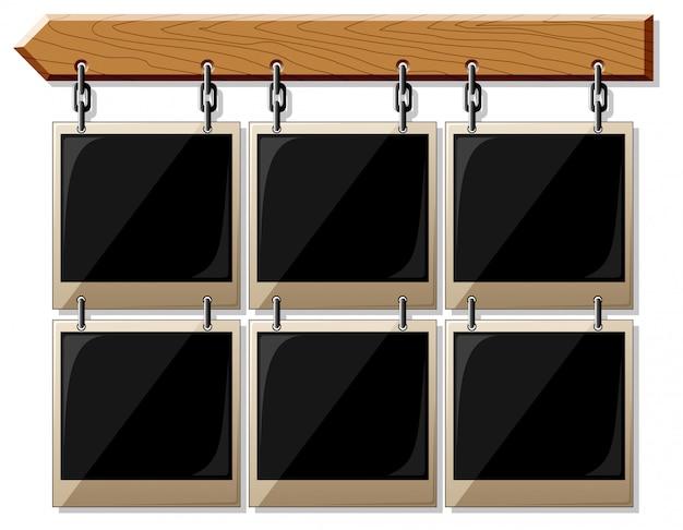 Tavola di legno con cornici vuote lucide