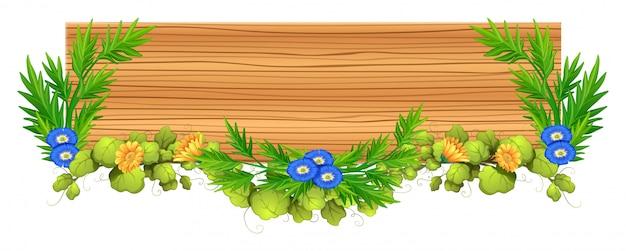 Tavola di legno con vite e fiori