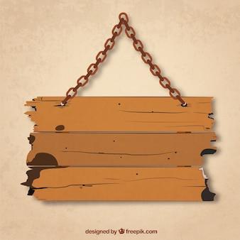 Tavola di legno di grunge appeso su una catena