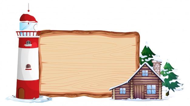Tavola di legno e casa invernale