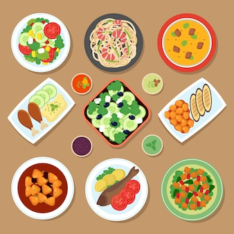 Tavolo da pranzo vista dall'alto con piatti europei e cucina giapponese