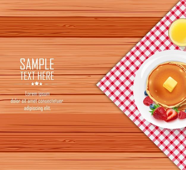 Tavolo per la colazione con pancake e burro su un piatto