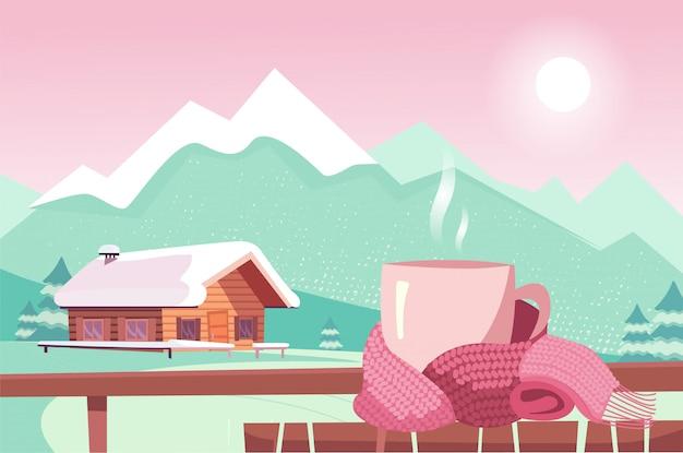 Tazza in sciarpa magenta sulla tavola su fondo del mountain view