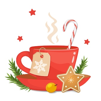 Tazza rossa con biscotto di natale a forma di stella, bastoncino di zucchero duro a strisce e natale