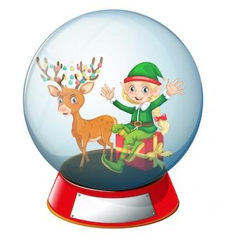 Tema di natale con elfo e renne in palla di vetro