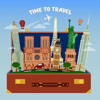 Tempo di viaggiare. valigia piena di luoghi di fama mondiale con aeroplano nel cielo