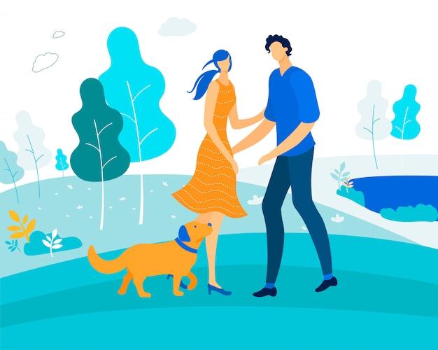Tempo libero con animali domestici, coppia felice giocando con il cane