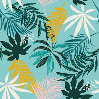 Tendenza modello tropicale senza cuciture con foglie e piante colorate