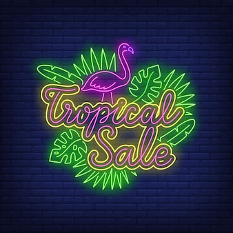 Testo al neon di vendita tropicale con fenicottero e foglie