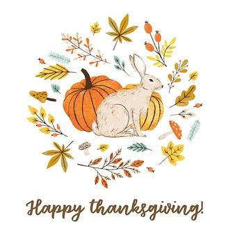Testo di calligrafia di ringraziamento felice con coniglietto e zucche disegnati a mano.