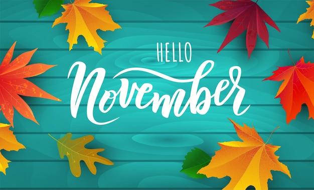 Testo di novembre. tipografia scritta a mano con foglie autunnali luminose.