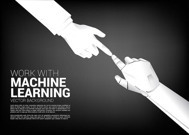 Tocco del robot con il dito dell'uomo d'affari. concetto di nascita dell'era della macchina di apprendimento.