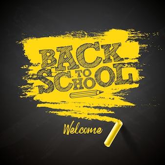 Torna a scuola lettering con gesso e tipografia scritte sulla lavagna nera