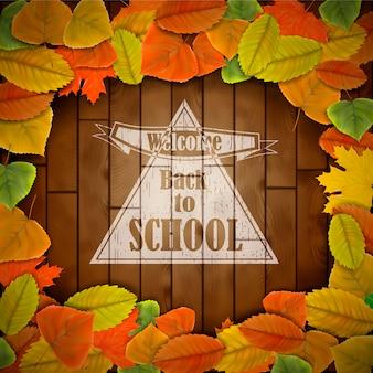 Torna a scuola sfondo in legno con foglie