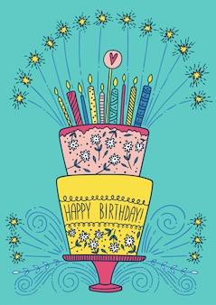 Torta di buon compleanno carino con candele e fuochi d'artificio.