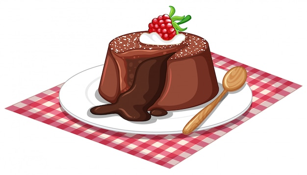 Torta di lava al cioccolato e cucchiaio di legno sul piatto