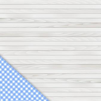 Tovaglia d'angolo blu sul tavolo di legno bianco