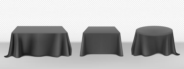 Tovaglia nera realistica di vettore sui tavoli