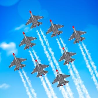 Tracce di condensazione militari di formazione degli aeroplani del jet di parata dell'aeronautica dell'esercito contro cielo blu