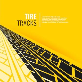 Tracce di pneumatici in prospettiva su sfondo giallo om