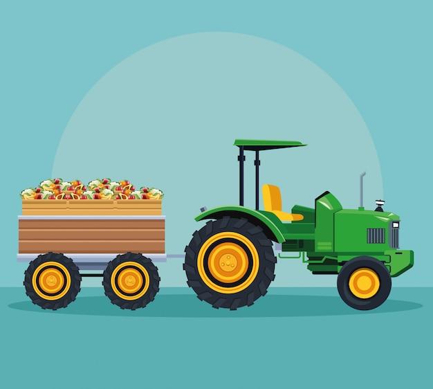 Trattore agricolo che spinge frutti con il carrello