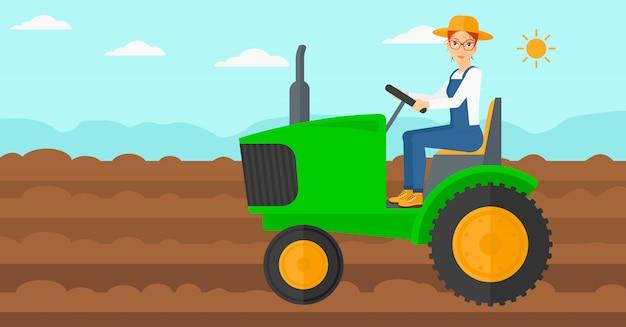 Trattore alla guida dell'agricoltore.