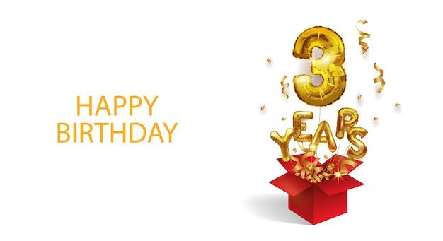 Tre anni dalla nascita. numero 3 un palloncino di foil volante vola fuori da una scatola di coriandoli. festa di compleanno.