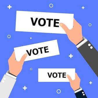 Tre mani tengono tabelle etichettate voto