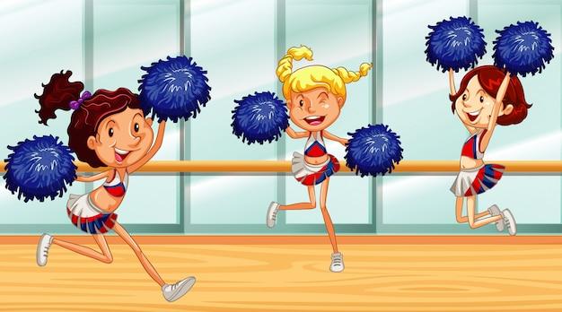 Tre ragazze pon pon che ballano nella stanza