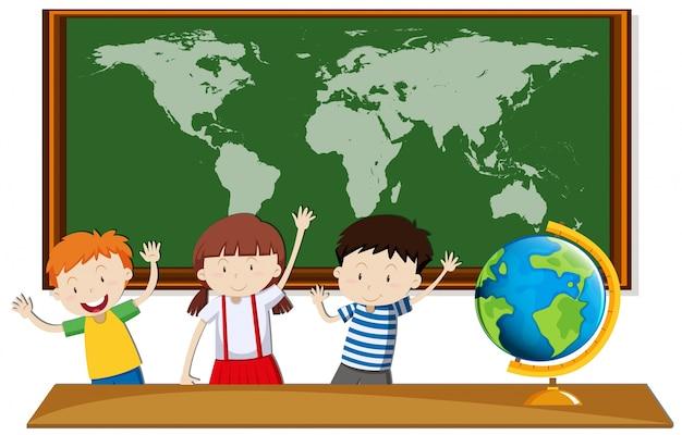 Tre studenti studiano geografia in classe