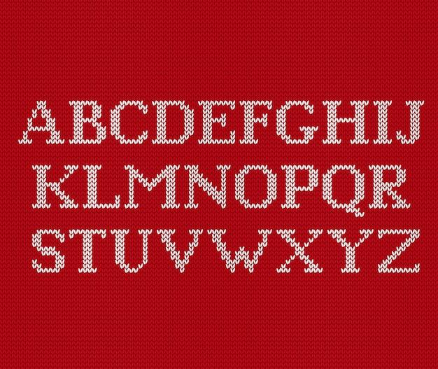 Tricottare il modello senza cuciture con l'alfabeto del testo