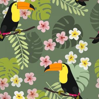 Tucano con foglie e fiori tropicali.