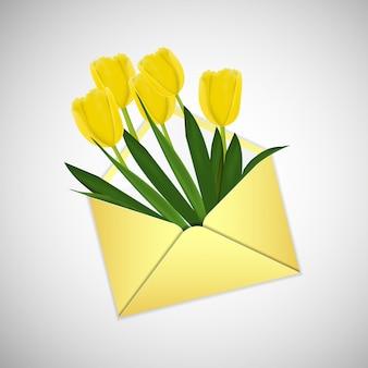 Tulipani gialli in una busta dorata. 8 marzo e concetto di festa della mamma.